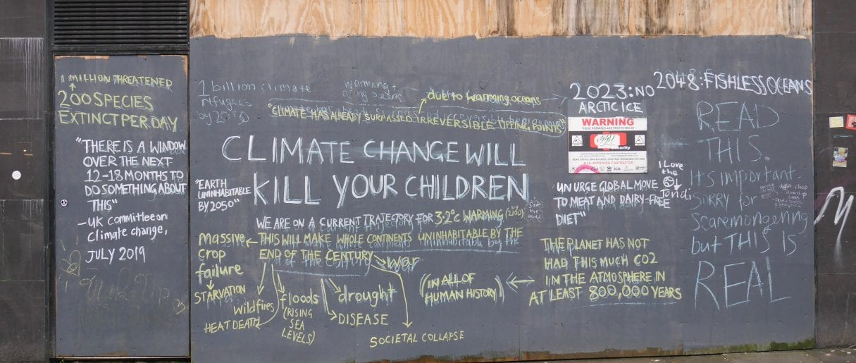 Glasgow. Blackboard reads 'Climate Change will kill your children'